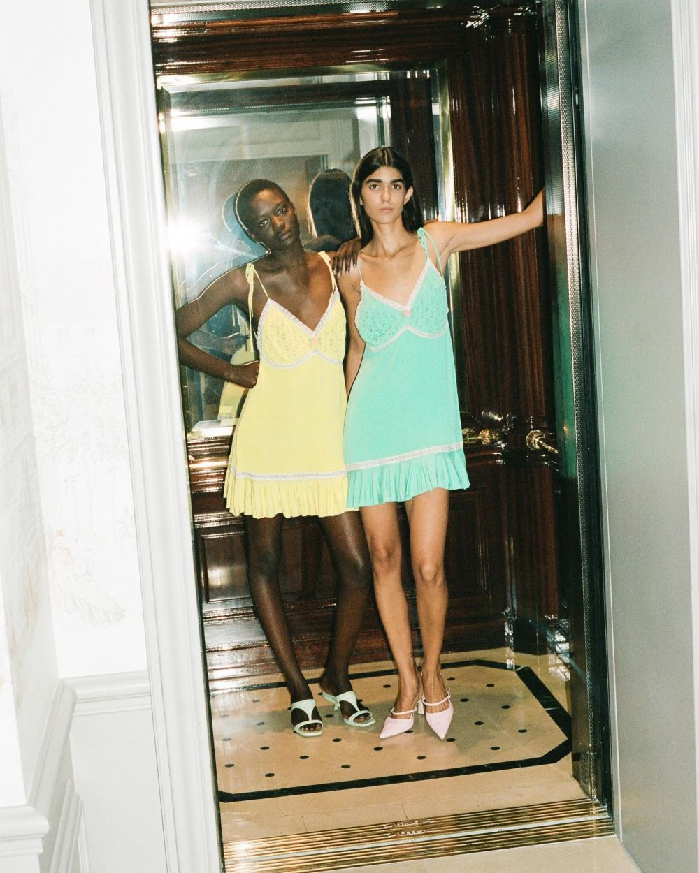 Our Summer collection is about possibilities. Some will remain dreams and fantasies, some might become a reality.  Let's start by fantasizing about the Summer of 2022 with our campaign of two friends shot at a beautiful hotel in Paris. 📸   Rebeca and Maty are both wearing knitted dresses Sienna. You can pre-order them now on our webshop ~ Link in bio. #SS22