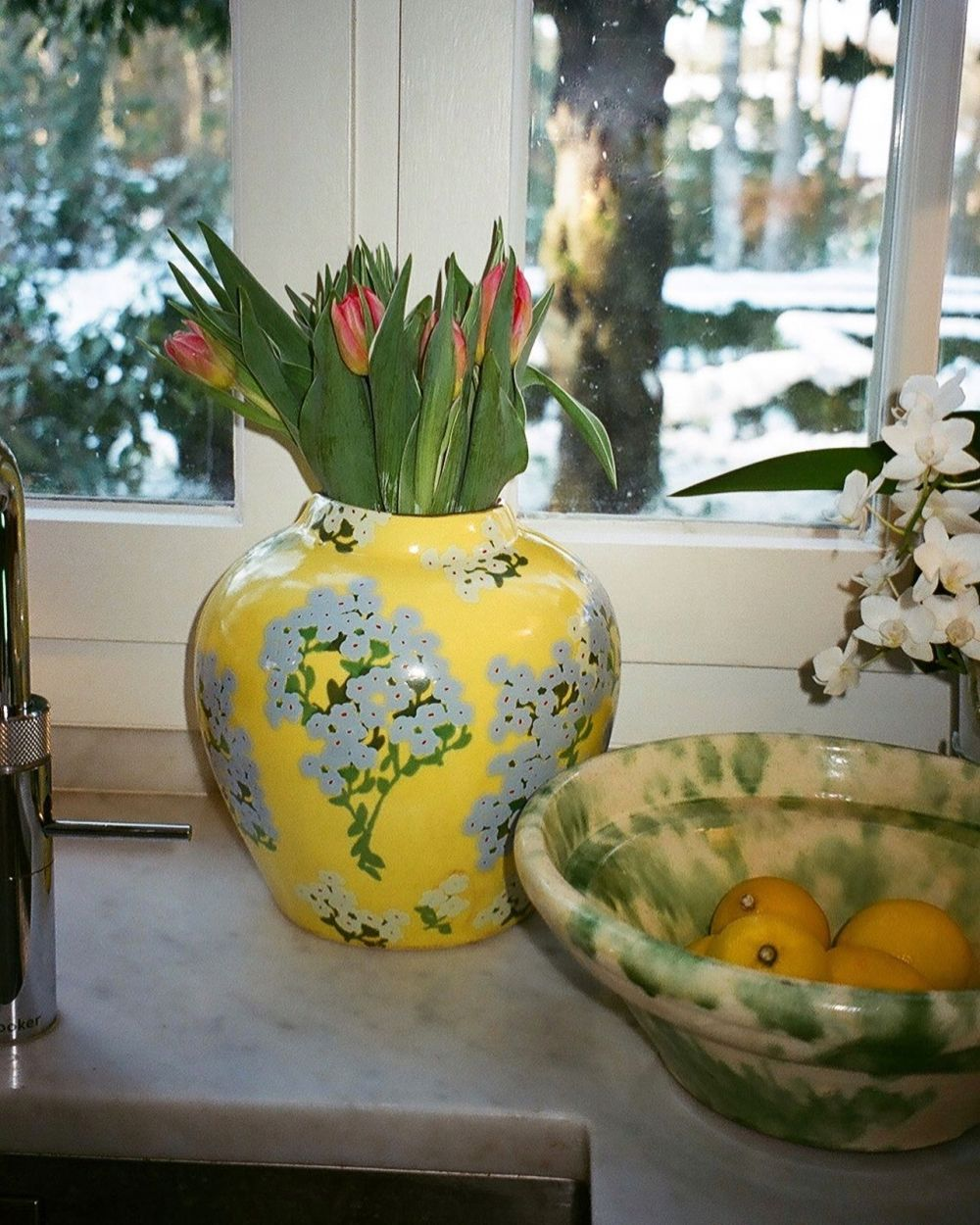 BLUE HORTENSIA ON A YELLOW CERAMIC BASE. ~ Our vases will launch in stores in June/July & we're counting down the days! 💛