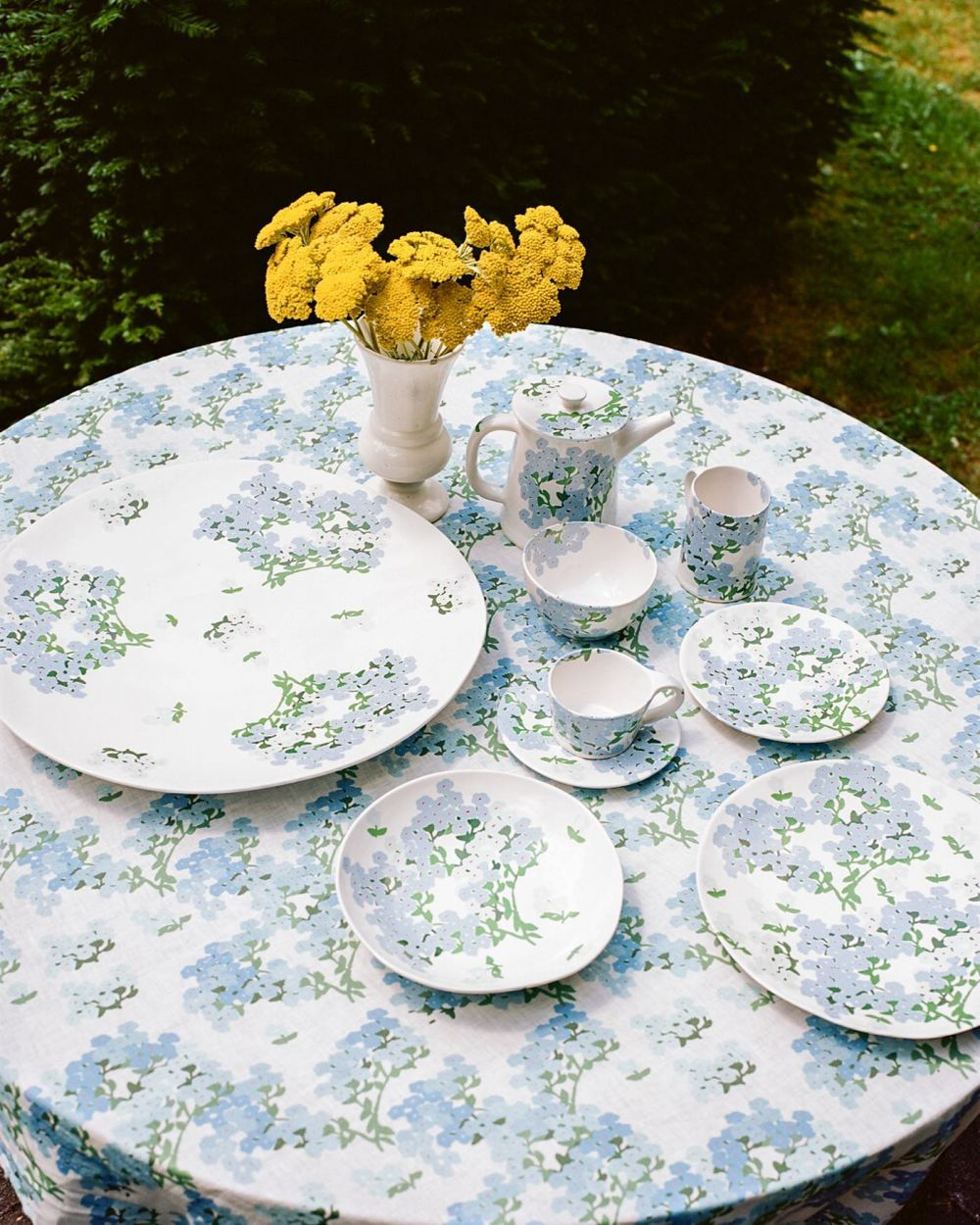 The Blue Hortensia ceramic set and tablecloth.   Now available at selected stores worldwide and on our webshop.  Shot by @evadonckers