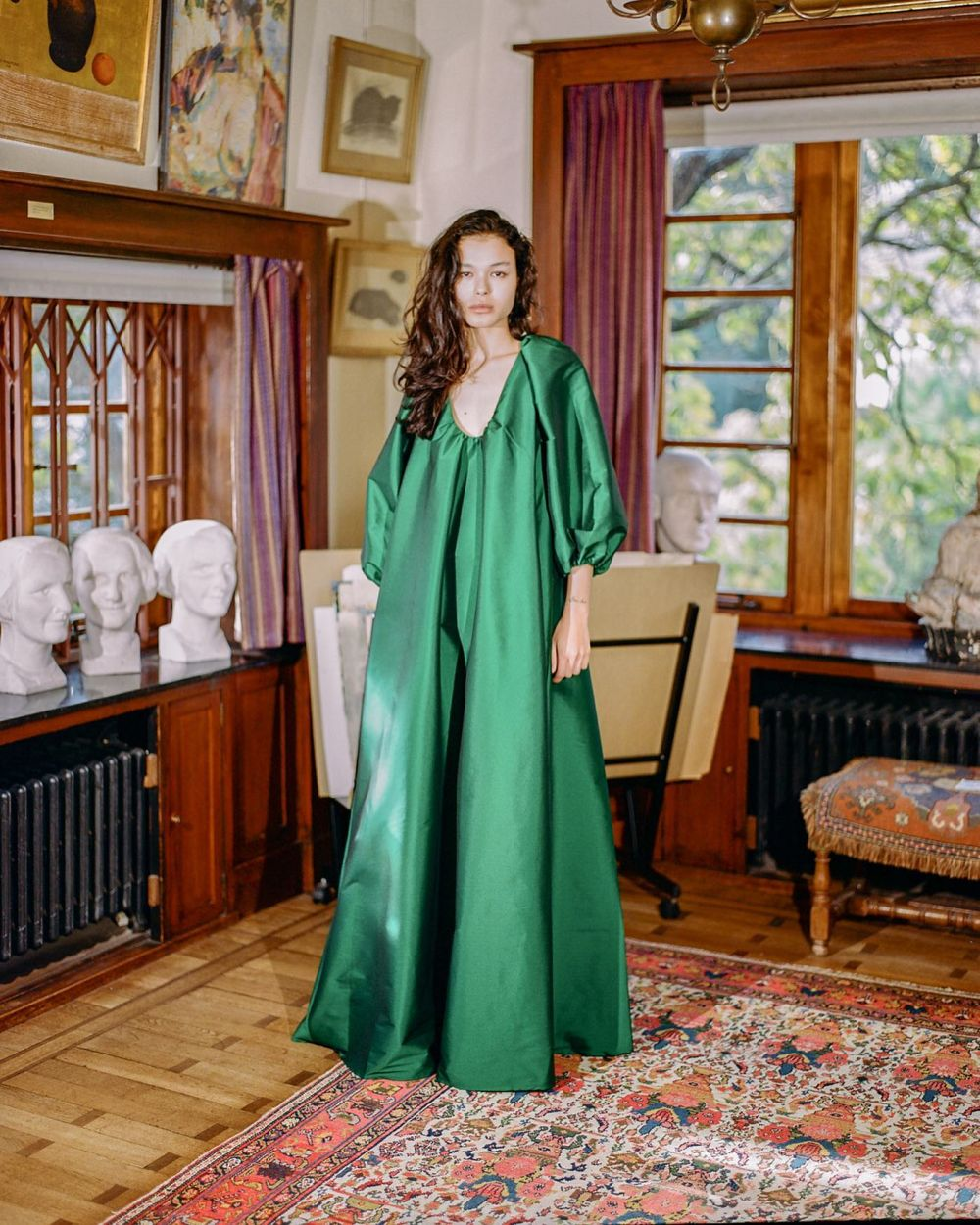 JEWARIA WEARING THE EMERALD GREEN GEORGE DRESS. 💚  Shot at the wonderful Museum Van Buuren ~ capturing the warm and seductive atmosphere of our #PS21 collection.  Photographer @evadonckers  Model @jewaria   Exclusively available @matchesfashion. #PS21