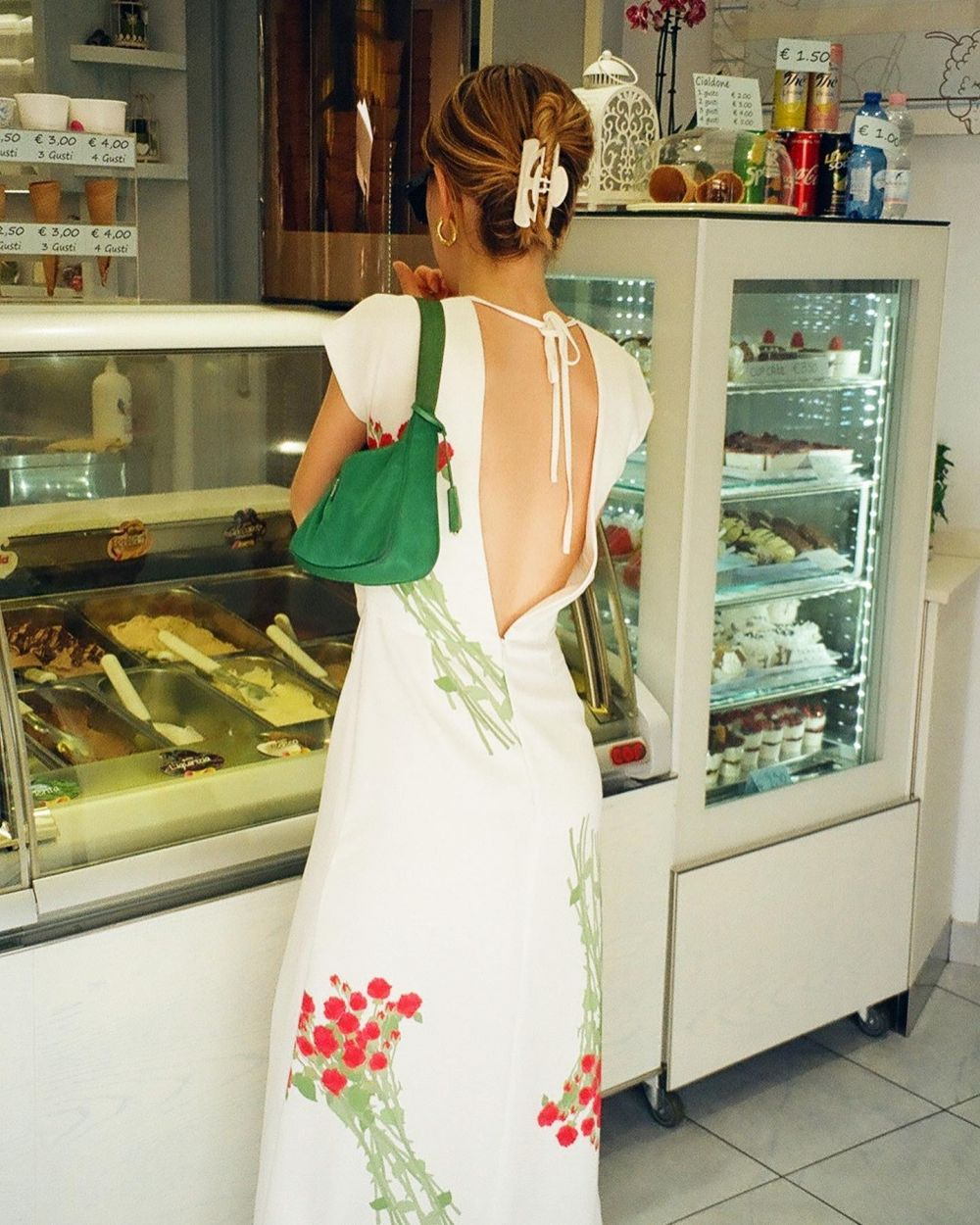 SOFIE ORDERING GELATO ~ WEARING DRESS ANNE.🍦🍧  Three of my friends and I visited Como. We packed only one suitcase filled with BERNADETTE and off we went. We strutted down the streets of Bellagio with our bags jam-packed with floral dresses and silks.   Changing at every corner, capturing our florals in the beauty of Northern Italy. It was so fun to see the girls' take on the Summer collection. Each of them styled the pieces differently, putting their own spin on BERNADETTE.